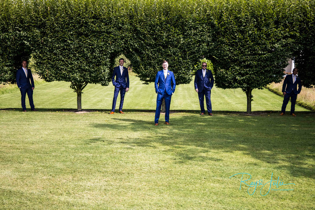 Groom and groomsman in background at Tickton Grange