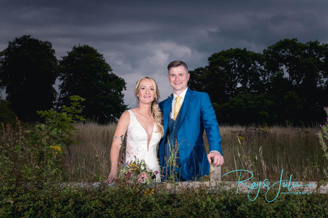 Bride and groom outdoor bridal portrait dramatic sky