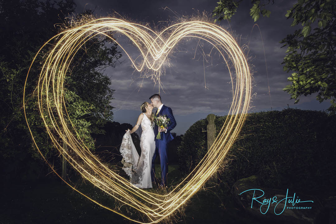 Bridal portrait with heart shaped sparkler around them