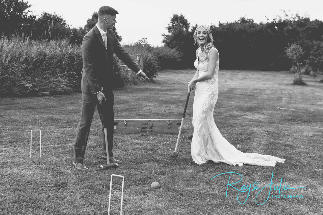Bride and Groom playing croquet at Tickton Grange