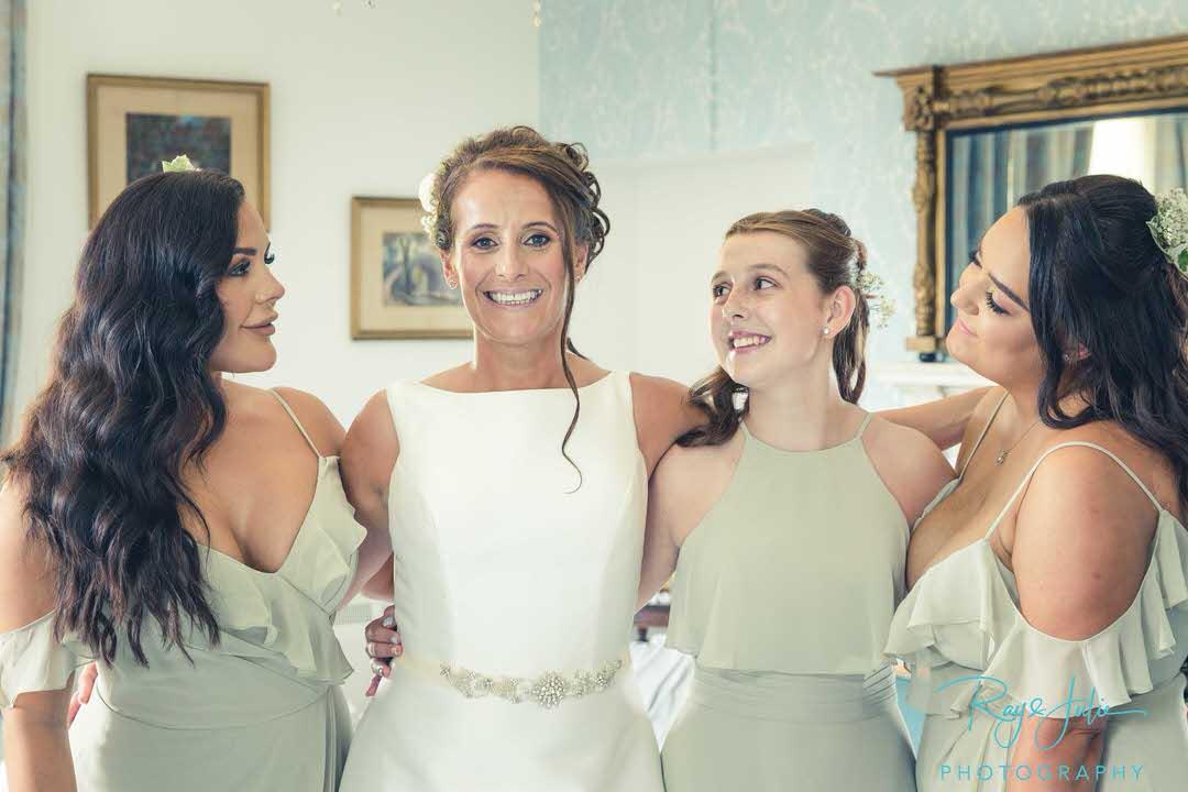 Bride with bridesmaids all happy