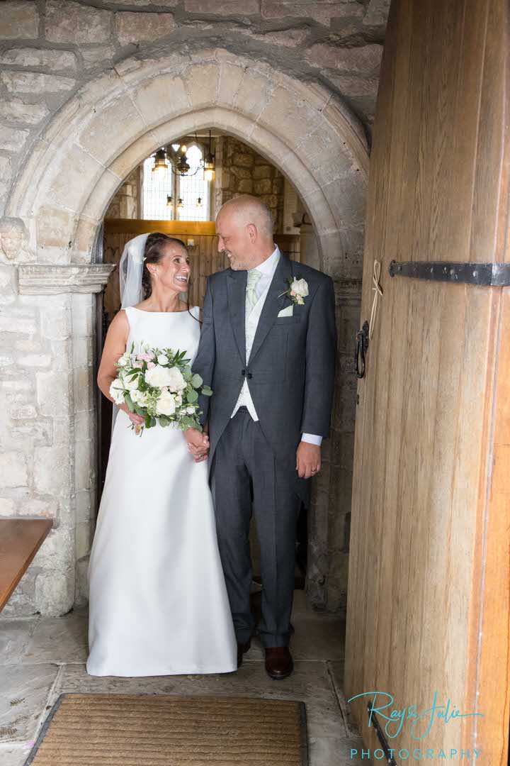 Bride and Groom leaving the church after getting married