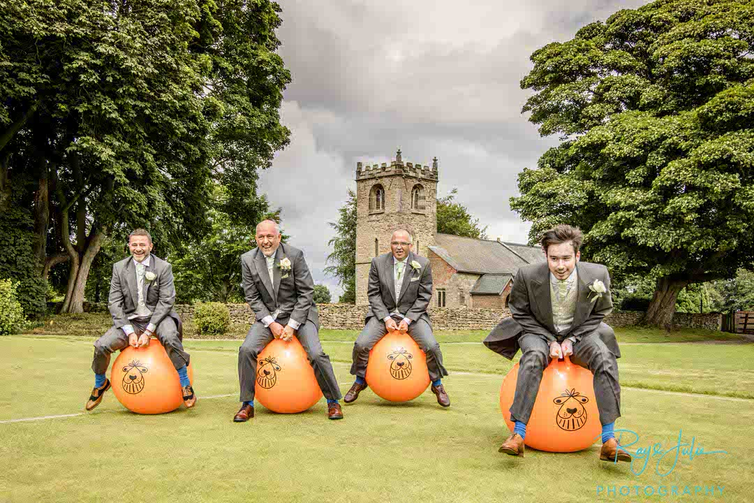 Groom and groomsmen on space hoppers at Rowley Manor