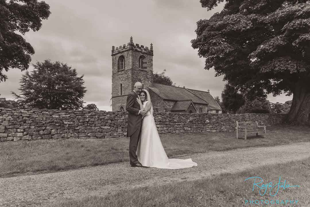 Wedding couple at Rowley Manor East Yorkshire St Peters Church in the background