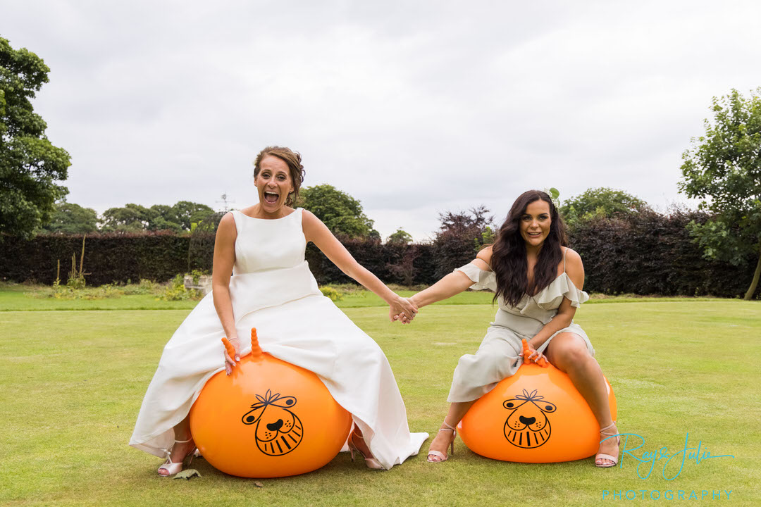 Bride and daughter on space hoppers