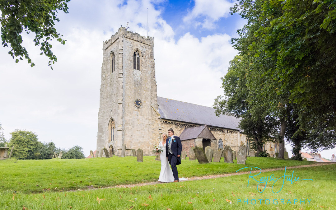 Newley married wedding couple walking hand in hand from Kilham Church